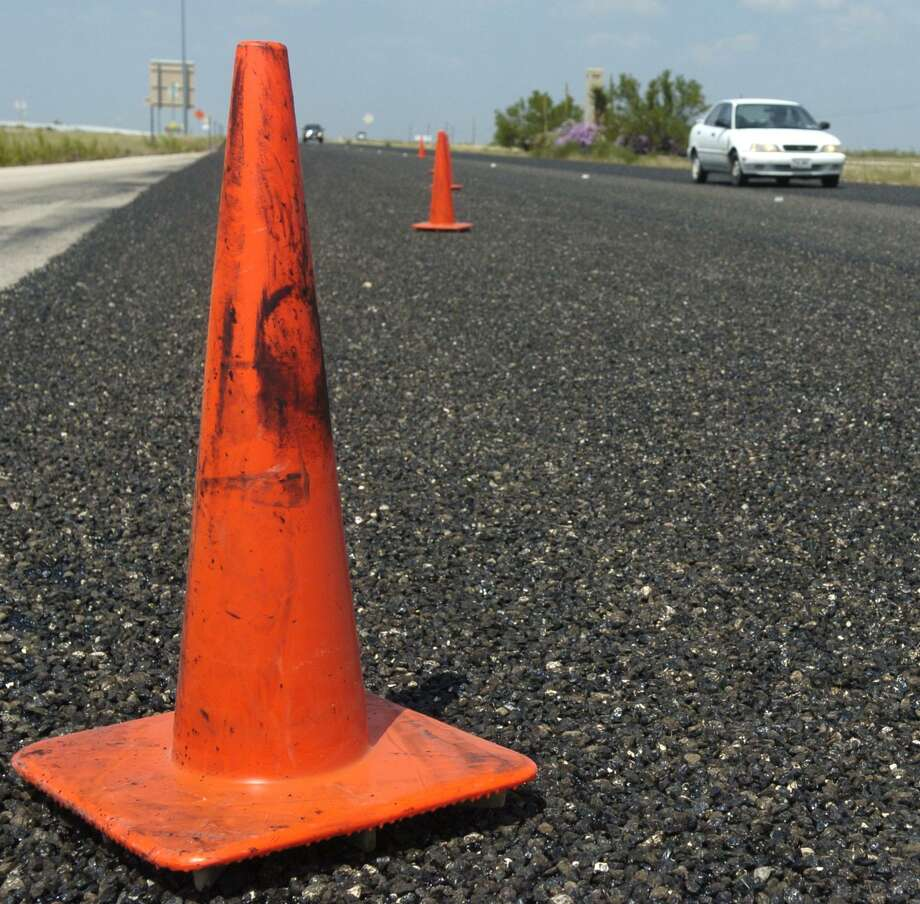 Miles of orange cones line Highway 191 limiting traffic to one lane from Midland to Odessa as TXDOT resurfaces the roadway. Photo by Tim FIscher 8/14/07 / Midland