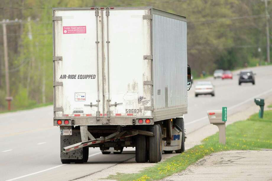 A semi-truck travels down a Michigan road. (Neil Blake/MLive.com) / mlive.com