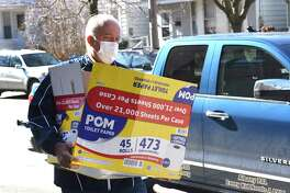 Members of Albany Police Athletic League (PAL) including Leonard Ricchiuti, Jr., executive director, deliver bags of cheer to some of the homebound seniors at St. Vincent?•s Apartments on Friday, March 27, 2020 in Albany, N.Y. They're also delivering to Holy Wisdom and St. Sophia?•s, and the South Mall Towers. (Lori Van Buren/Times Union)