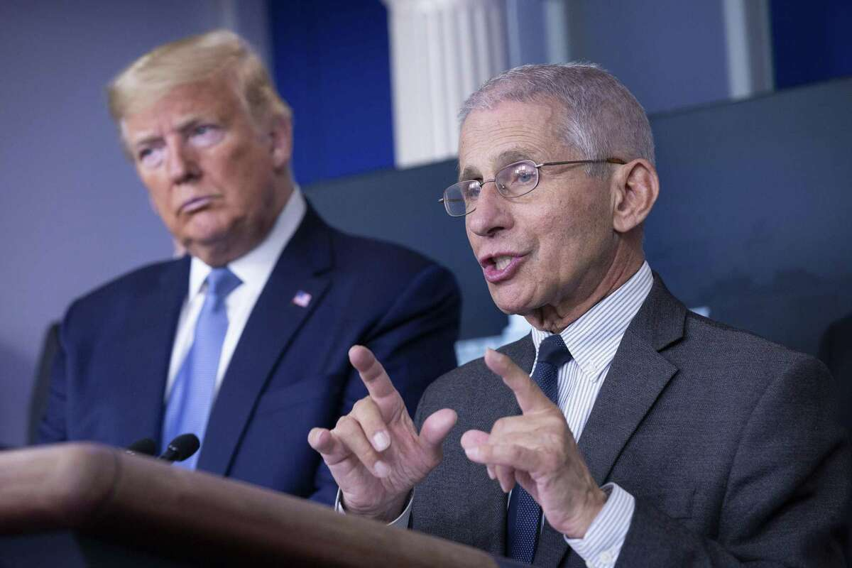 """Anthony Fauci, director of the National Institute of Allergy and Infectious Diseases, right, speaks during a Coronavirus Task Force news conference in the briefing room of the White House in Washington, D.C., U.S., on Saturday, March 21, 2020. President Donald Trump said negotiators in Congress and his administration are """"very close"""" to agreement on a coronavirus economic-relief plan that his economic adviser said will aim to boost the U.S. economy by about $2 trillion. Photographer: Stefani Reynolds/CNP/Bloomberg"""