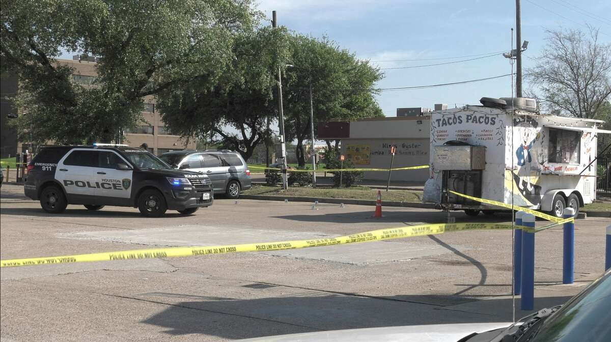 Houston police officers investigate a deadly shooting in the 9800 block of Beechnut on Friday, March 27, 2020.