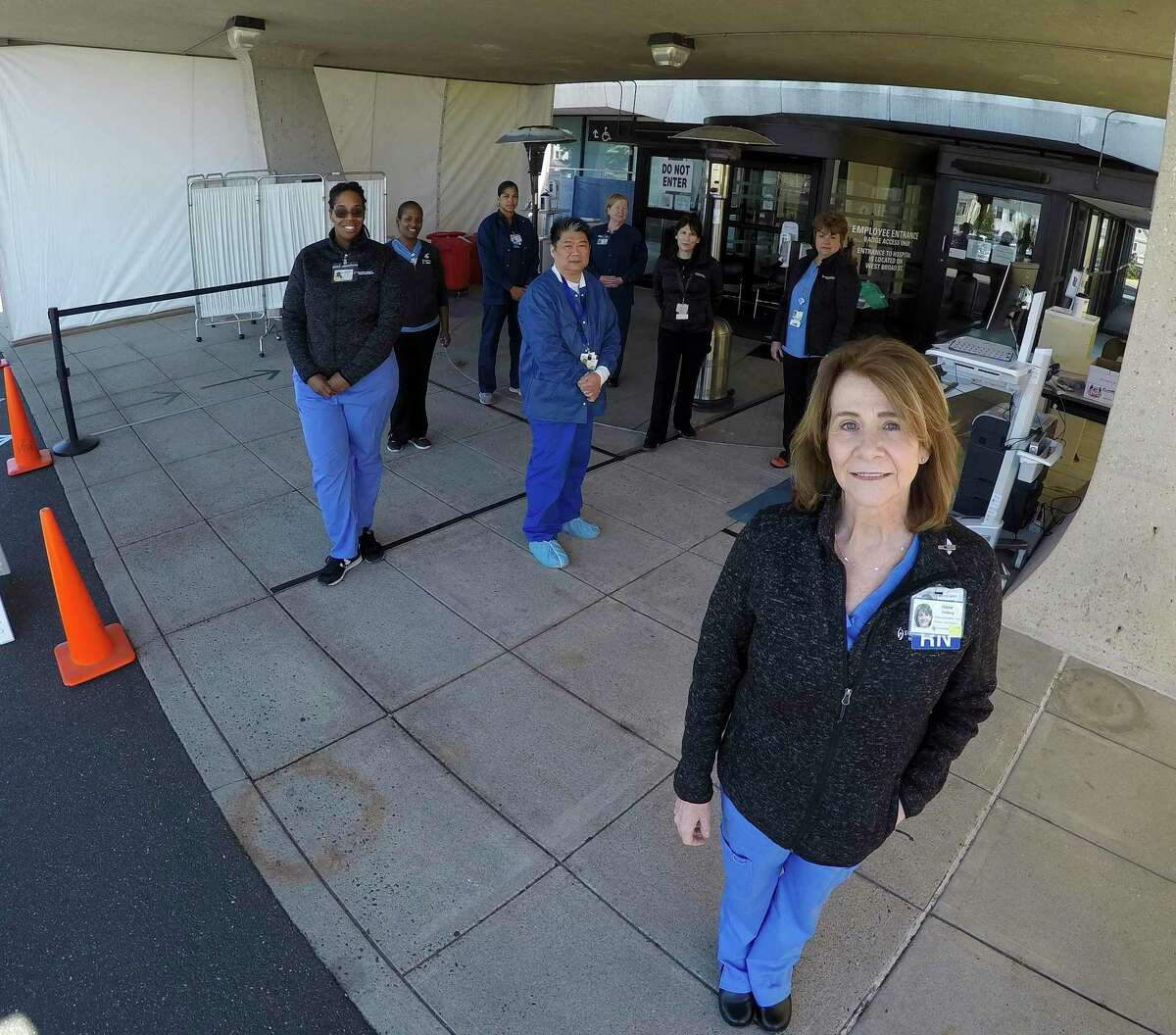 At right, Irene Furlong, Director of Clinical Services at Stamford Health Medical Group, is photographed on March 26, 2020 with her team of medical personel. Furlong is overseeing the drive-thru COVID-19 testing facility that has been set up at Stamford Hospital.