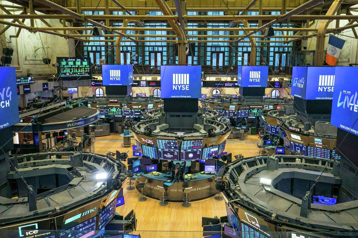 The NYSE trading floor has been closed temporarily for the first time in 228 years as a result of coronavirus concerns, but trading goes on. What's happening in the stock market these past four weeks is not new, says financial columnist Michael Taylor. Rather, it's a 100-year flood that periodically recurs, well, about every 10 years.