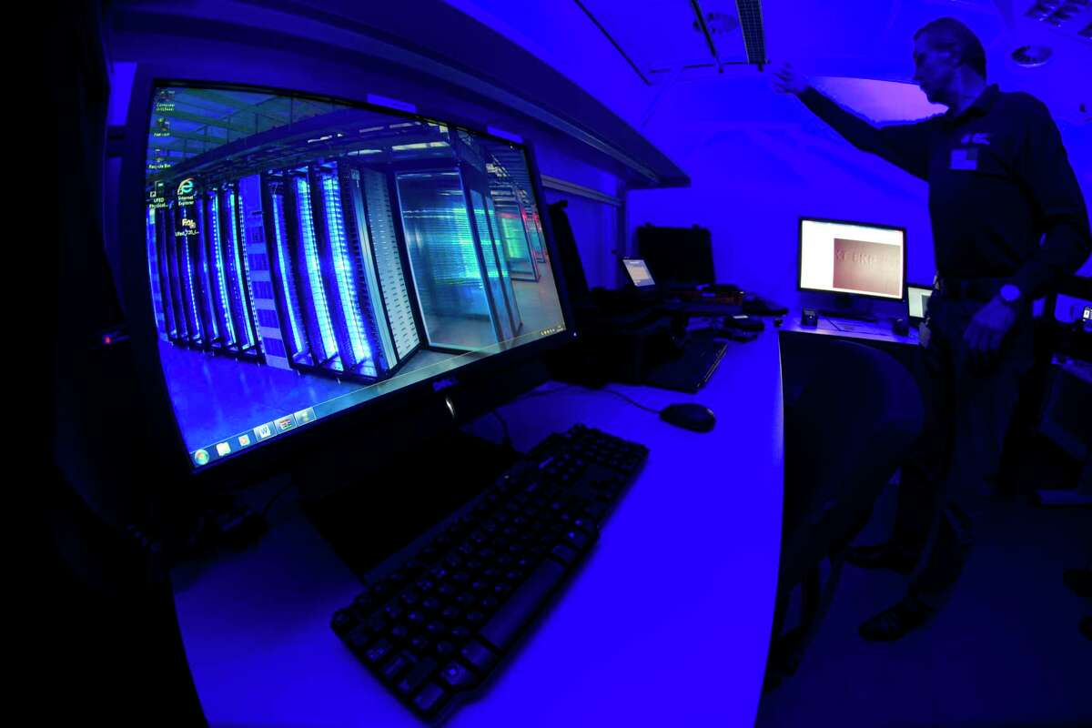 A member of the Cybercrime Center as he turns on the light in a lab during a media tour at the occasion of the official opening of the Cybercrime Center at Europol headquarters in The Hague, Netherlands. Criminals have spotted a new business opportunity with the coronavirus pandemic and are now plundering the needy and the fearful and even disrupting the medical sector, online and off, with fraud, counterfeit products and cybercrime, a report issued Friday by the European law enforcement agency Europol says.
