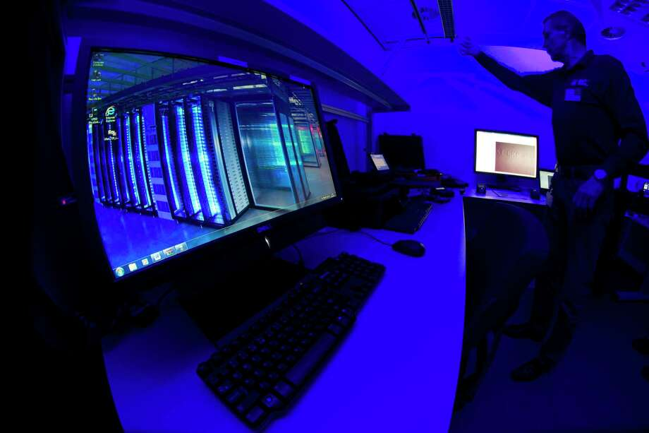 A member of the Cybercrime Center as he turns on the light in a lab during a media tour at the occasion of the official opening of the Cybercrime Center at Europol headquarters in The Hague, Netherlands. Criminals have spotted a new business opportunity with the coronavirus pandemic and are now plundering the needy and the fearful and even disrupting the medical sector, online and off, with fraud, counterfeit products and cybercrime, a report issued Friday by the European law enforcement agency Europol says. Photo: Peter Dejong / Associated Press / Copyright 2019 The Associated Press. All rights reserved.