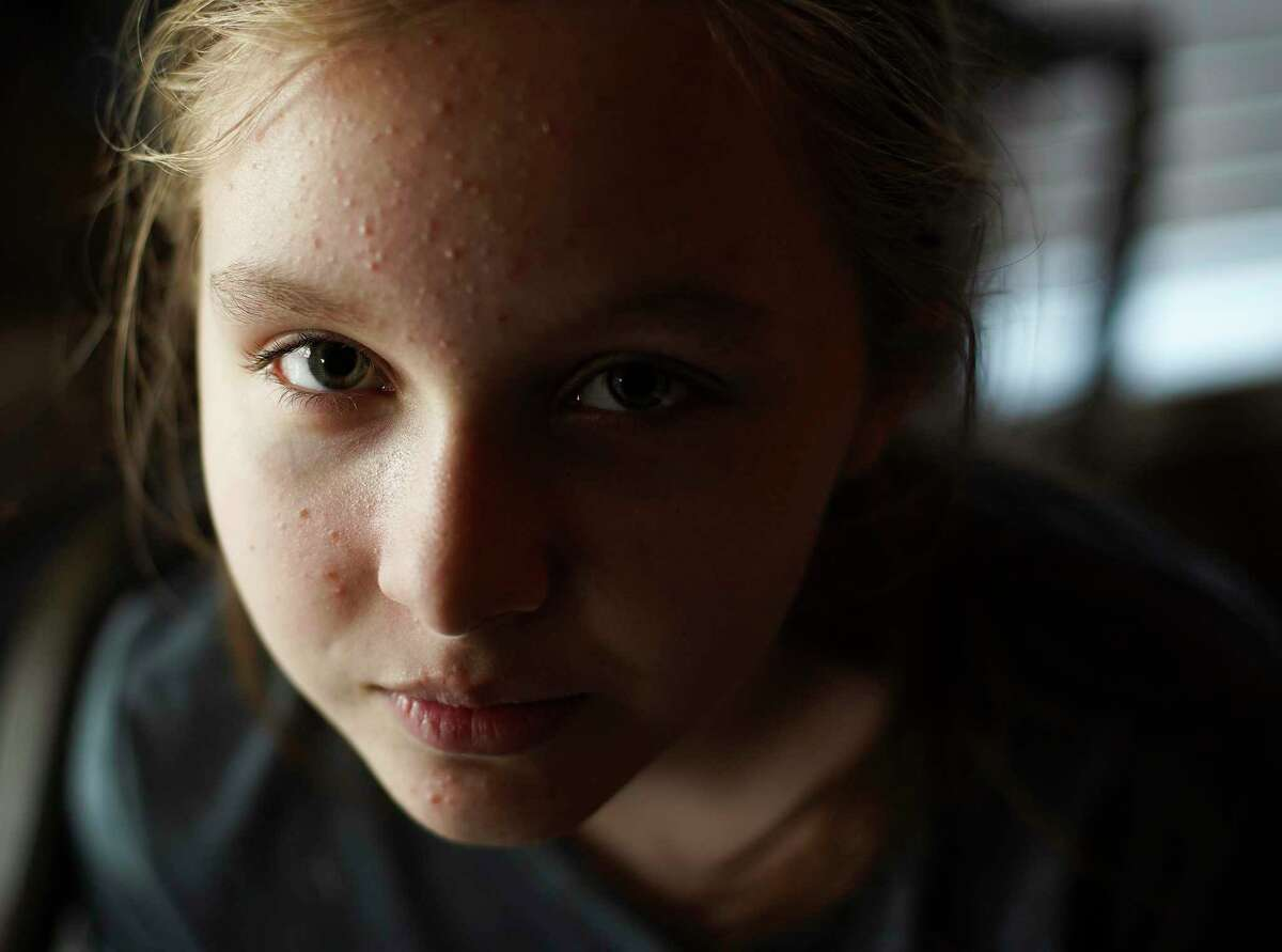 Issy Powell, 12, in her Kingwood home.