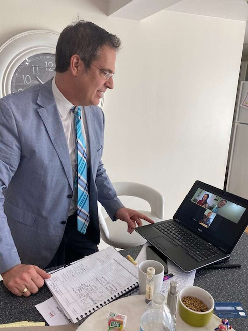 Real estate agent Scott Varley is using the video conferencing platform Zoom to meet with clients, fellow agents and staff during the coronavirus quarantine.