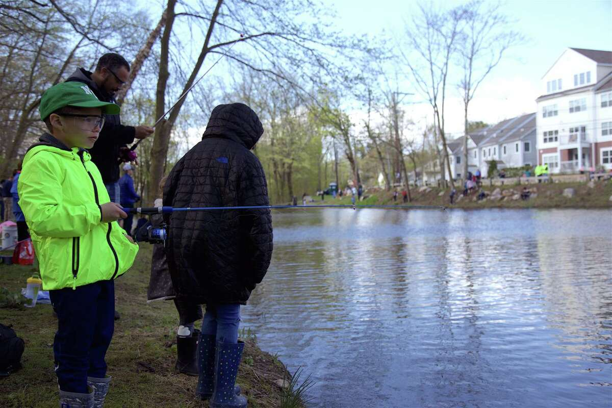Micah Lister, 5, of New Canaan, waits for a bite during a previous George Cogswell Memorial Fishing Derby on Mill Pond.