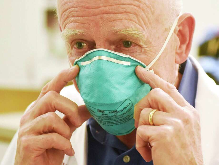 Dr. Michael Parry, chief of infectious diseases at Stamford Hospital, demonstrates an N-95 medical mask while speaking about the coronavirus. Photo: Tyler Sizemore / Hearst Connecticut Media / Greenwich Time