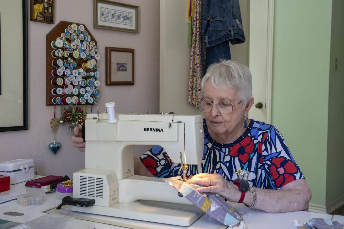 Carol Magnum sews medical masks on Wednesday, March 25, 2020 at 2906 Northtown Place.