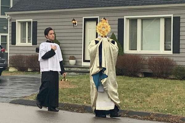 The Rev. Peter Cipriani, the 50-year-old pastor of Our Lady of the Assumption Roman Catholic parish, takes to the streets of Fairfield.