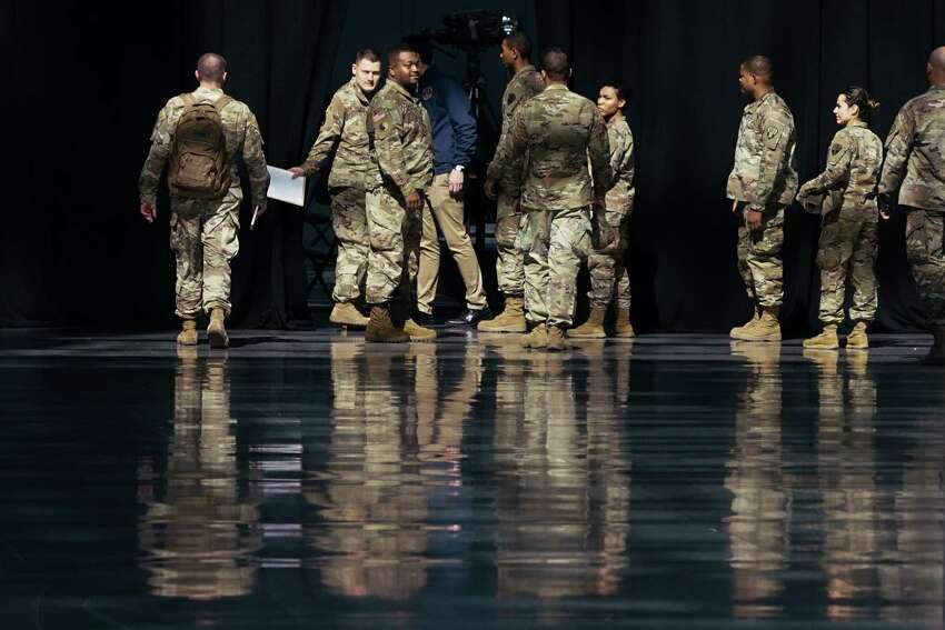 NEW YORK, NY - MARCH 27: Members of the National Guard wait the arrival of New York Gov Andrew Cuomo at the Javits Convention Center, which is being turned into a hospital to help fight coronavirus cases on March 27, 2020 in New York City. Across the country, schools, businesses, and places of work have either been shutdown or are restricting hours of operation as health officials try to slow the spread of COVID-19.