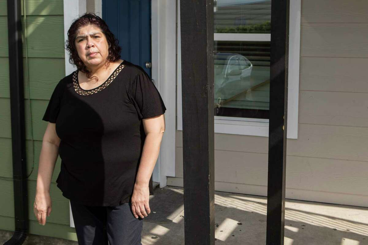 Anna Alvarez, who is a wheelchair attendant at George Bush Intercontinental Airport, stands outside her apartment on Thursday, March 26, 2020 in Houston. She and two of her daughters, who all work at IAH, and have now seen their weekly paychecks slashed by at least 85 percent.