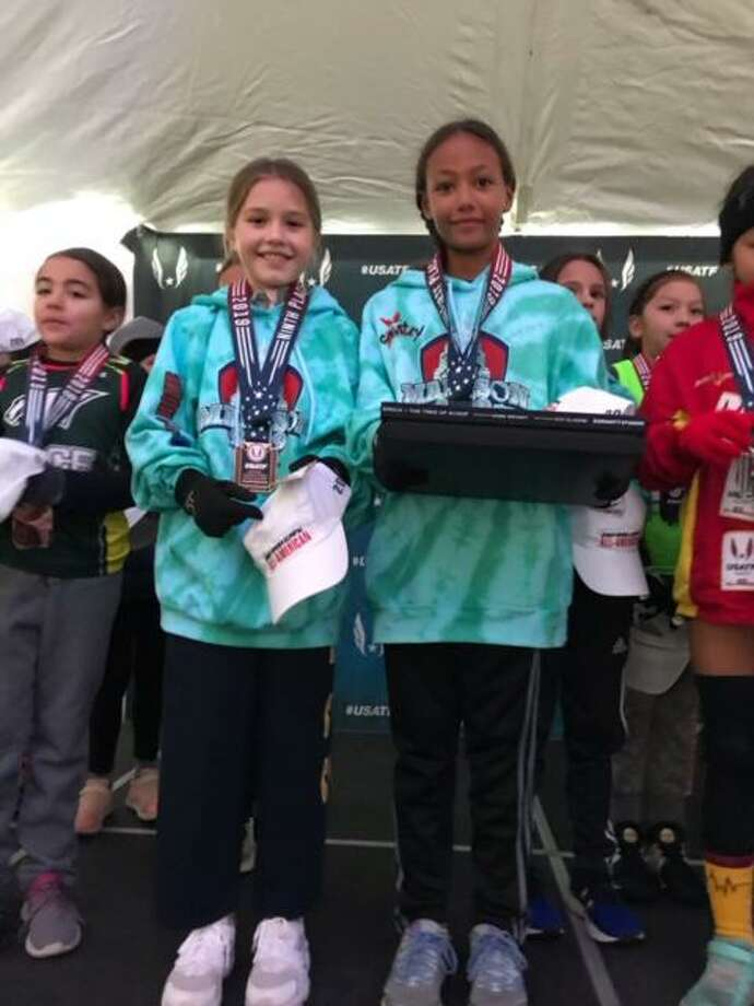 Country School third graders Laila Goodman of Old Lyme and Tillie Killam of Madison earned All-America status by taking first place and ninth place among 157 runners in the Junior Olympics Cross Country Championships. Photo: Contributed Photo /