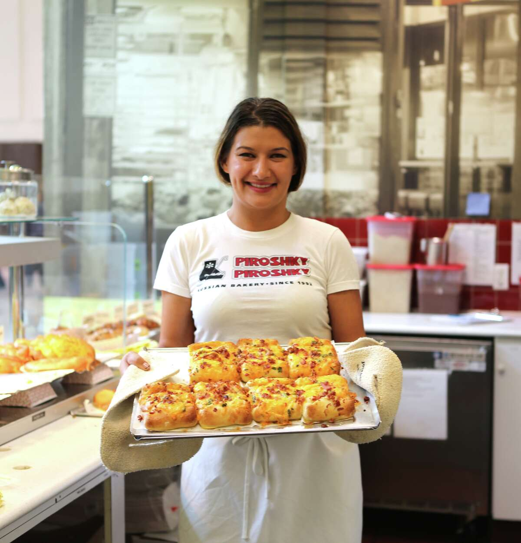 Piroshky Piroshky owner, Olga Sagan, divvies out freshly baked breads.