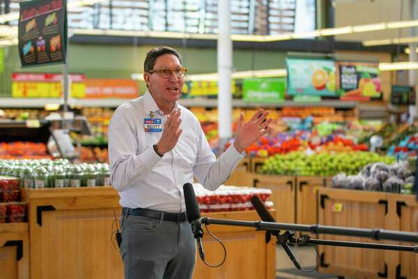 H-E-B president Scott McClelland talks about the grocery store company's efforts to keep their stores fully stocked, Friday, March 27, 2020, at the H-E-B Montrose Market in Houston.