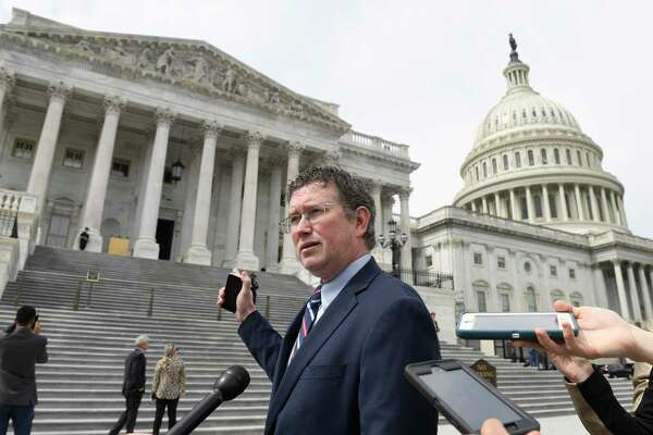 Rep. Thomas Massie, R-Ky., talks to reporters before leaving Capitol Hill in Washington, Friday, March 27, 2020, after attempting to slow action on a rescue package. Despite Massie's effort, the House, acting with exceptional resolve in an extraordinary time, rushed President Donald Trump a $2.2 trillion rescue package, tossing a life preserver to a U.S. economy and health care system left flailing by the coronavirus pandemic.