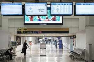 One of the two security checkpoints is closed in Terminal A at George Bush Intercontinental Airport on Wednesday, March 25, 2020 in Spring. Traffic and flight schedules at the airport has been cut drastically, due to coronavirus precautions.