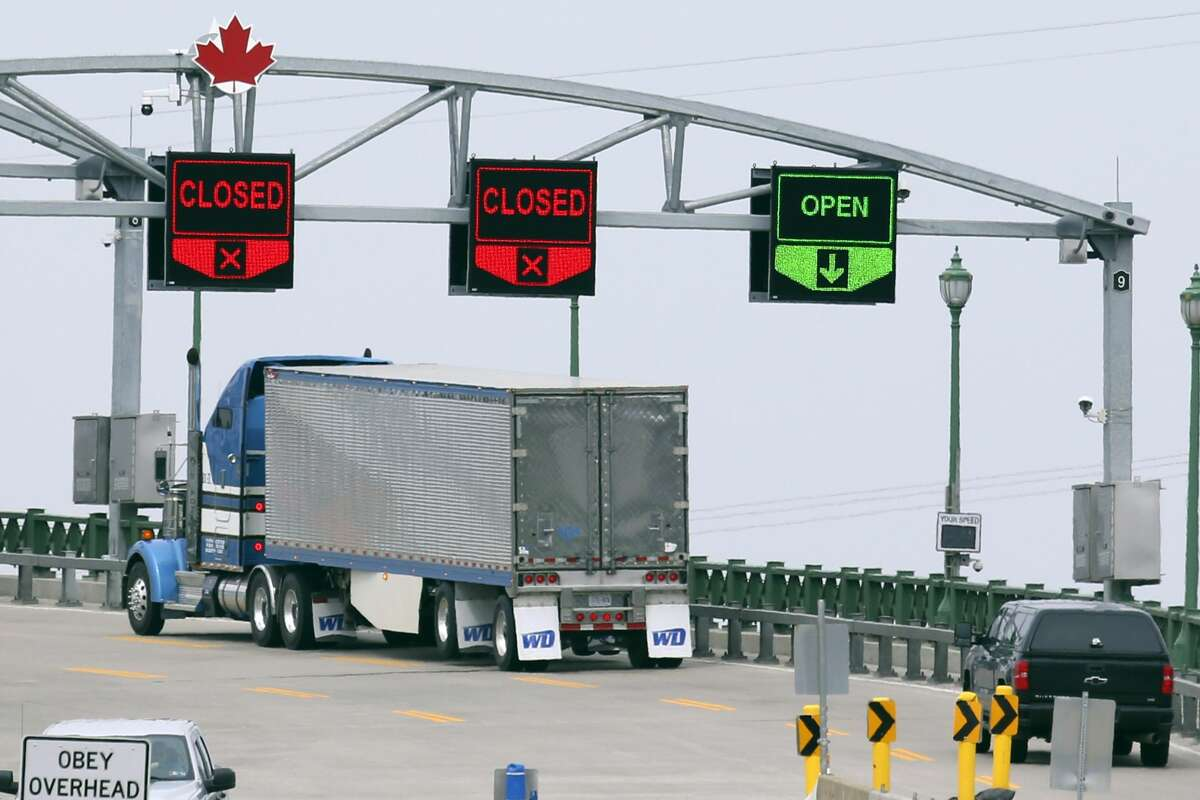 Vehicles cross the Peace Bridge into Canada Wednesday, March 18, 2020, in Buffalo N.Y., The Canada-U.S. border will be closed to non-essential traffic in both directions