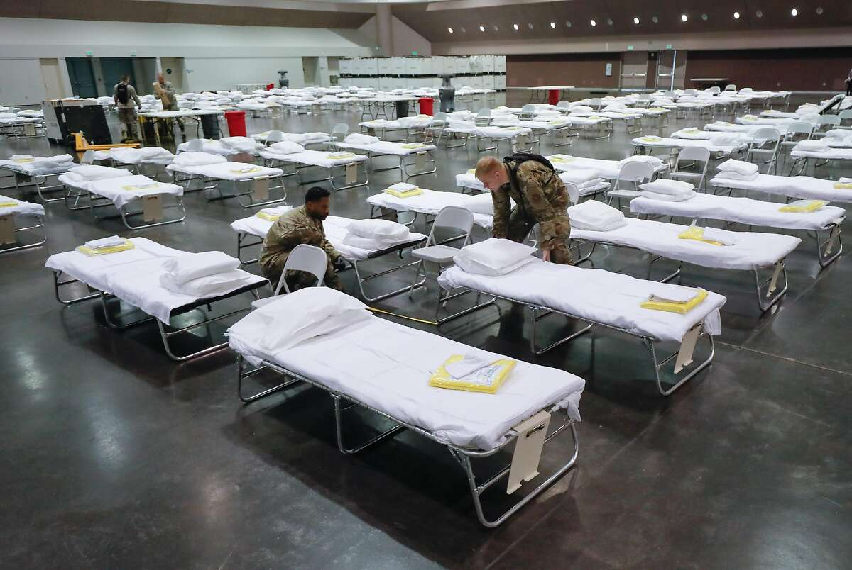 Members of the California Air National Guard, Channel Islands, assemble a COVID-19 hospital at the Santa Clara Convention Center Friday, March 27, 2020, in Santa Clara, Calif. Santa Clara County is building the temporary hospital in case of a sudden surge in patients.