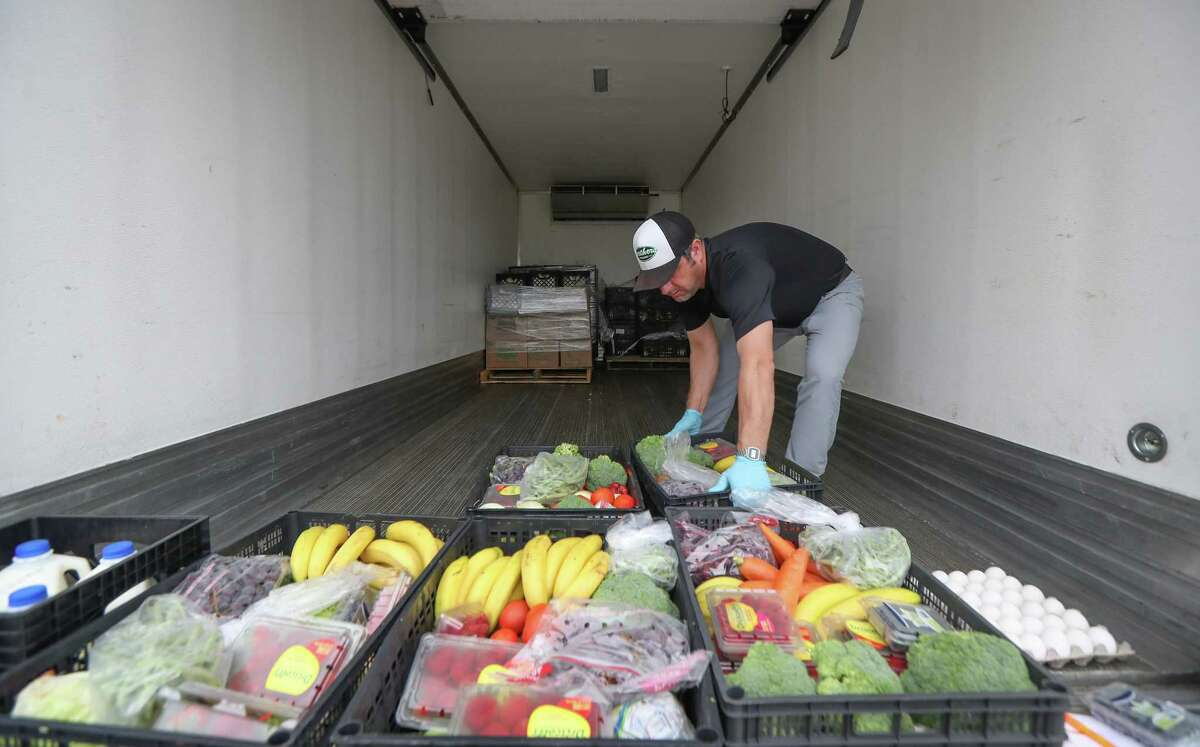 Brent Erenwert, the chief executive of the produce distributor for Brother's Produce, delivered boxes of fresh produce in Hope Lutheran Church's parking lot Wednesday, March 25, 2020, in Friendswood.