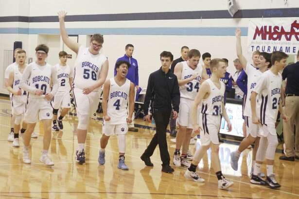 The Brethren boys basketball team thanks its home crowd after edging Onekama in a Division 4 district semifinal on March 11. The Bobcats were scheduled to face Frankfort for the district championship two nights later, but all sporting activities were suspended by the Michigan High School Athletic Association due to growing concerns over the spread of coronavirus. (News Advocate file photo)
