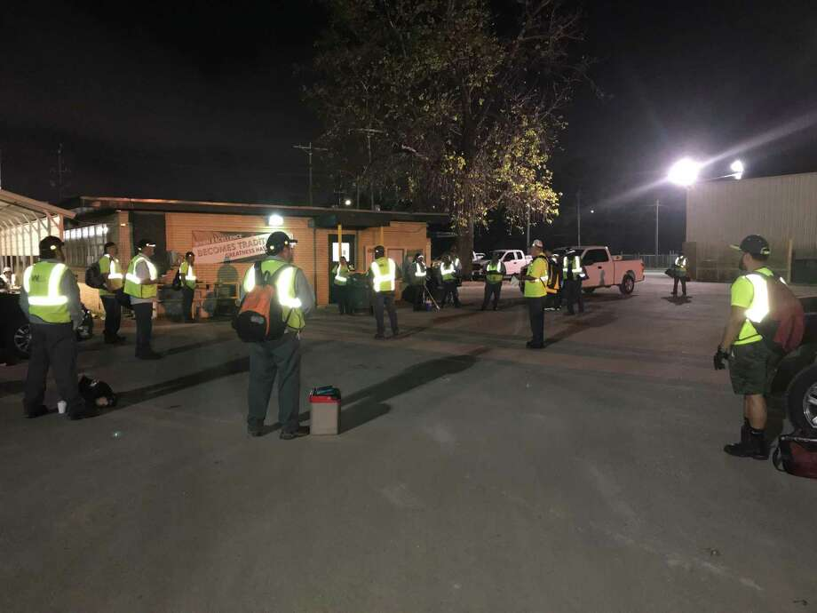 Waste Management employees in Houston practice social distancing at 5 a.m. March 26 as they gather before heading out to collect waste. Photo: Courtesy Waste Management / Courtesy Waste Management