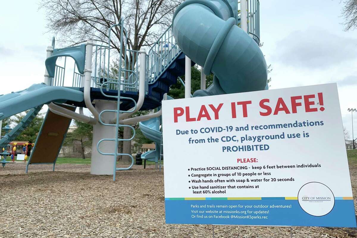Aa sign posted at a playground, serves as a reminder to parents that use of the playground is prohibited.