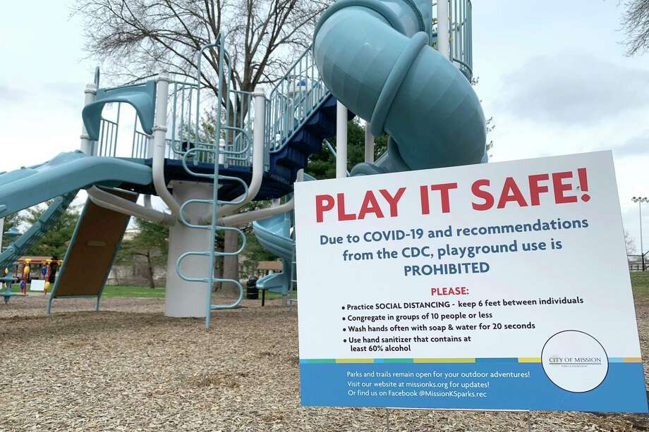 Aa sign posted at a playground, serves as a reminder to parents that use of the playground is prohibited. Photo: Associated Press / Copyright 2020 The Associated Press. All rights reserved.
