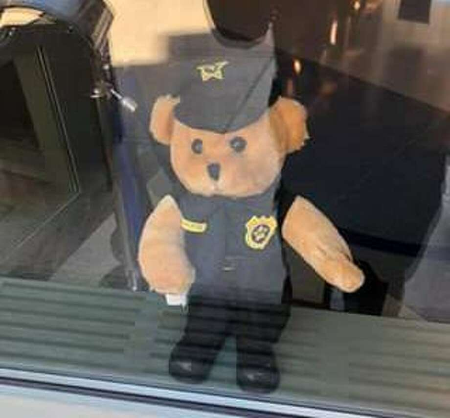 A Teddy bear at Greenwich police headquarters is part of an effort to make life fun for youngsters during the coronavirus outbreak. Photo: /
