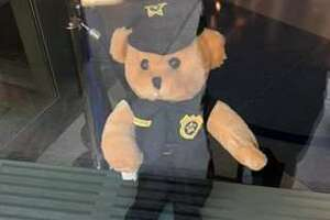 A Teddy bear at Greenwich police headquarters is part of an effort to make life fun for youngsters during the coronavirus outbreak.