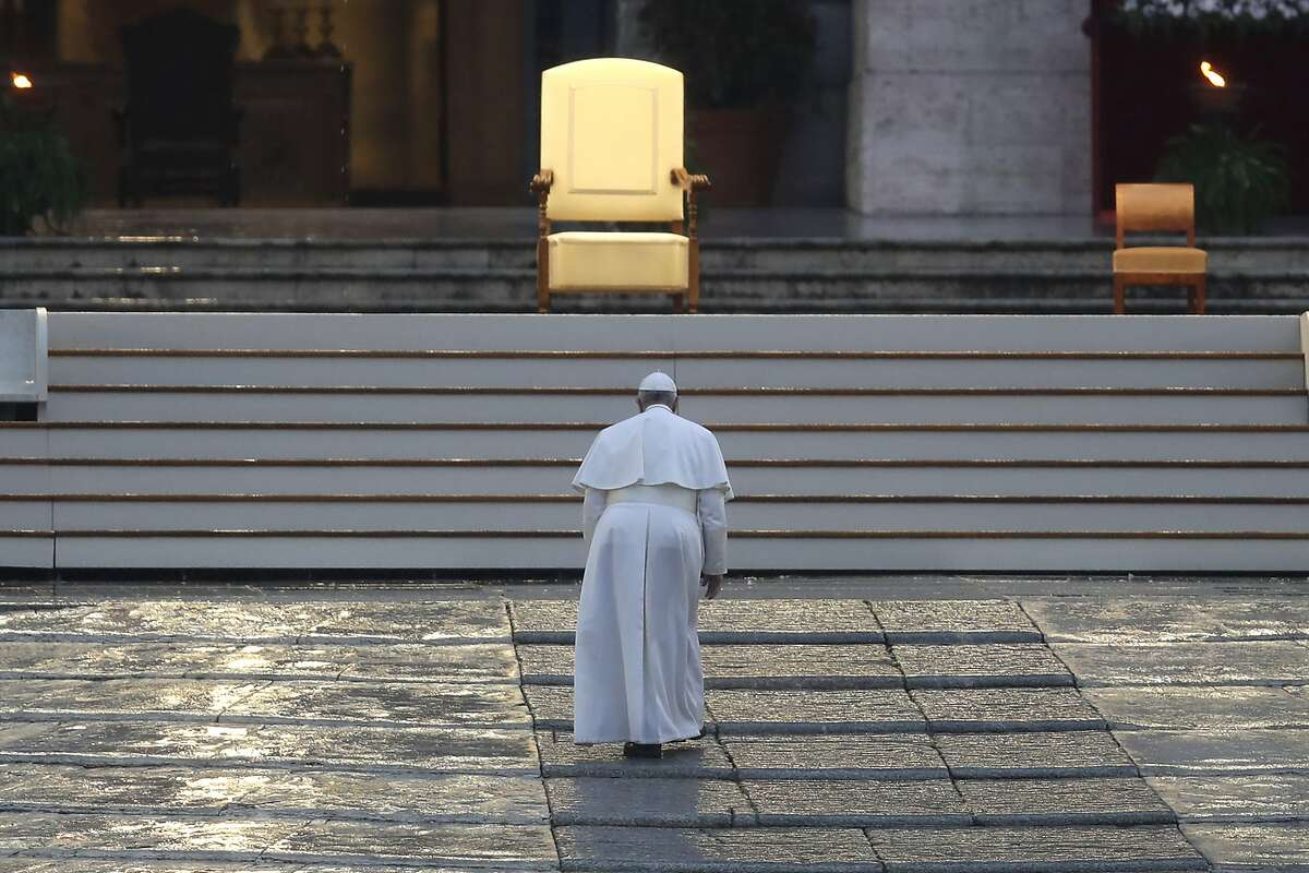 Pope Francis arrives to deliver an Urbi et orbi prayer from the empty St. Peter's Square, at the Vatican, Friday, March 27, 2020. Praying in a desolately empty St. Peter's Square, Pope Francis on Friday likened the coronavirus pandemic to a storm laying bare illusions that people can be self-sufficient and instead finds