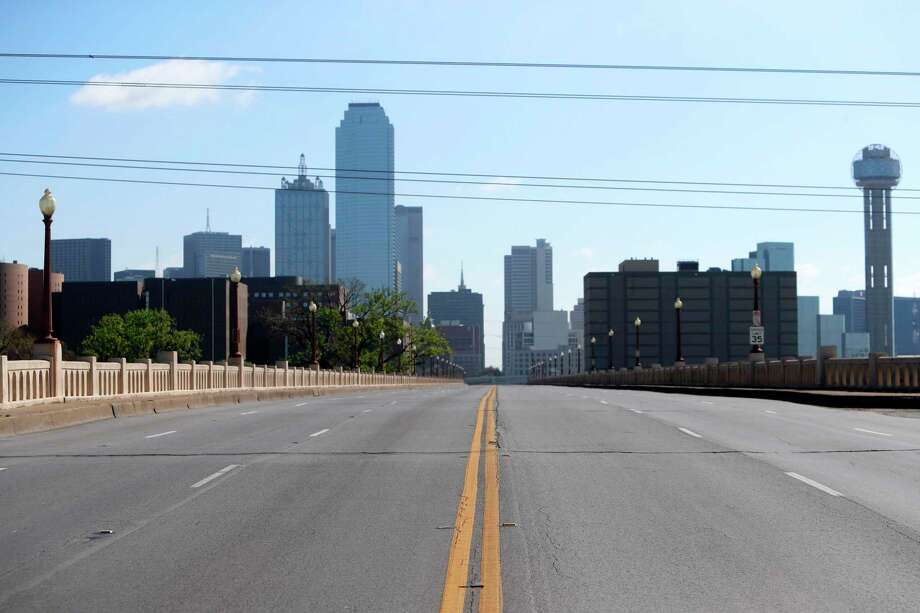 A normally busy road is empty in Dallas County as Texans hunker down during the COVID-19 pandemic. A reader urges Texans to follow orders and stay home. Photo: LM Otero /Associated Press / Copyright 2020 The Associated Press. All rights reserved.