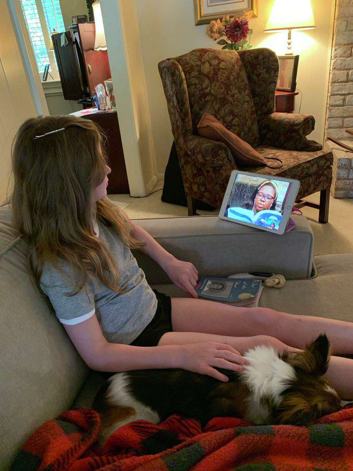 A Klein ISD student participates in a book discussion with her teacher on Zoom March 25, 2020, during the school district's first week of at-home learning.