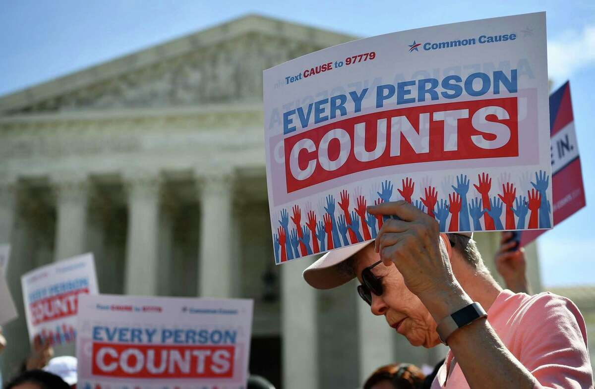 The Trump administration has also proposed excluding undocumented immigrants from the census, which would cost Texas billions in federal funds each year. Here, demonstrators rally for every person to be counted outside the U.S. Supreme Court in April.