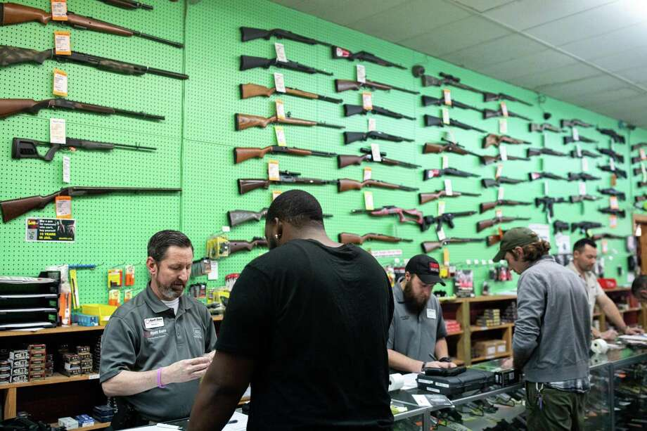 A gun shop in Charlotte, N.C., where the owner says sales of firearms have soared in recent weeks, on March 11. Gun shops have been deemed essential businesses here, covering the Second Amendment. A reader questions how closing churches jibes with the First Amendment. Photo: LOGAN R. CYRUS /NYT / NYTNS