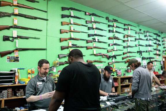 A gun shop in Charlotte, N.C., where the owner says sales of firearms have soared in recent weeks, on March 11. Gun shops have been deemed essential businesses here, covering the Second Amendment. A reader questions how closing churches jibes with the First Amendment.