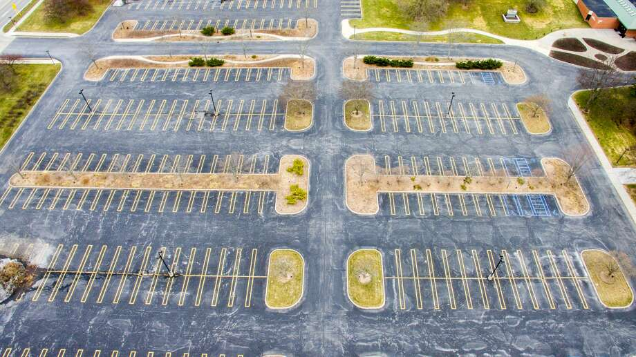 An aerial photograph shows the parking lot at Dow Gardens and the Midland Center for the Arts devoid of activity as many residents stay home to practice social distancing Thursday, March 26, 2020. (Adam Ferman/for the Daily News) Photo: (Adam Ferman/for The Daily News)