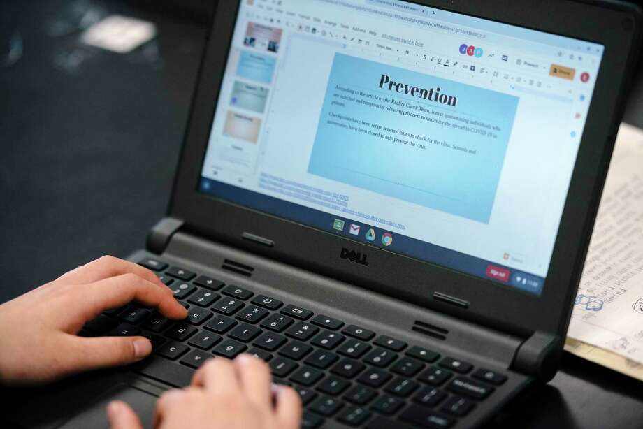 A student uses a laptop to research information on the Coronavirus during Mr. Mundahl's 11th grade Health Sciences class at the Phillip Burton Academic School in San Francisco, California, US, on Friday, March 13, 2020. The San Francisco Unified School District announced it would close schools for three weeks amid coronavirus concern starting on Monday, March 16th. Photo: Michael Short, Special To The Chronicle / Special To The Chronicle / Michael Short 2020
