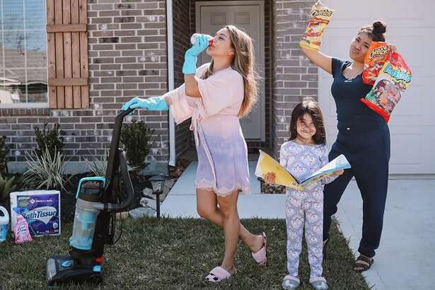 """Houston-based photographer, Yuli Vargas, came up with the idea of a creative neighborhood photo shoot. She captured how her neighbors were surviving """"Pandemic 2020"""" and staying safe."""