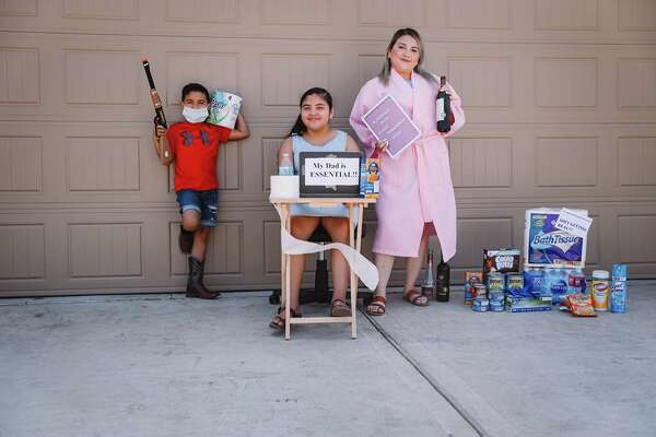 "Houston-based photographer, Yuli Vargas, came up with the idea of a creative neighborhood photo shoot.  She captured how her neighbors were surviving ""Pandemic 2020"" and staying safe."