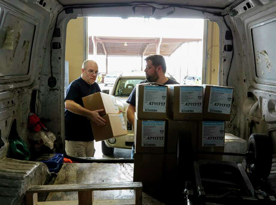 SETRAC Emergency Operations' Donald Morrison, left, and Austen McMillin load up medical supplies into a van from Memorial Hermann Hospital at the Strategic National Stockpile distribution site Wednesday, March 18, 2020, in Houston. Photo: Godofredo A. Vásquez, Houston Chronicle / Staff Photographer / © 2020 Houston Chronicle
