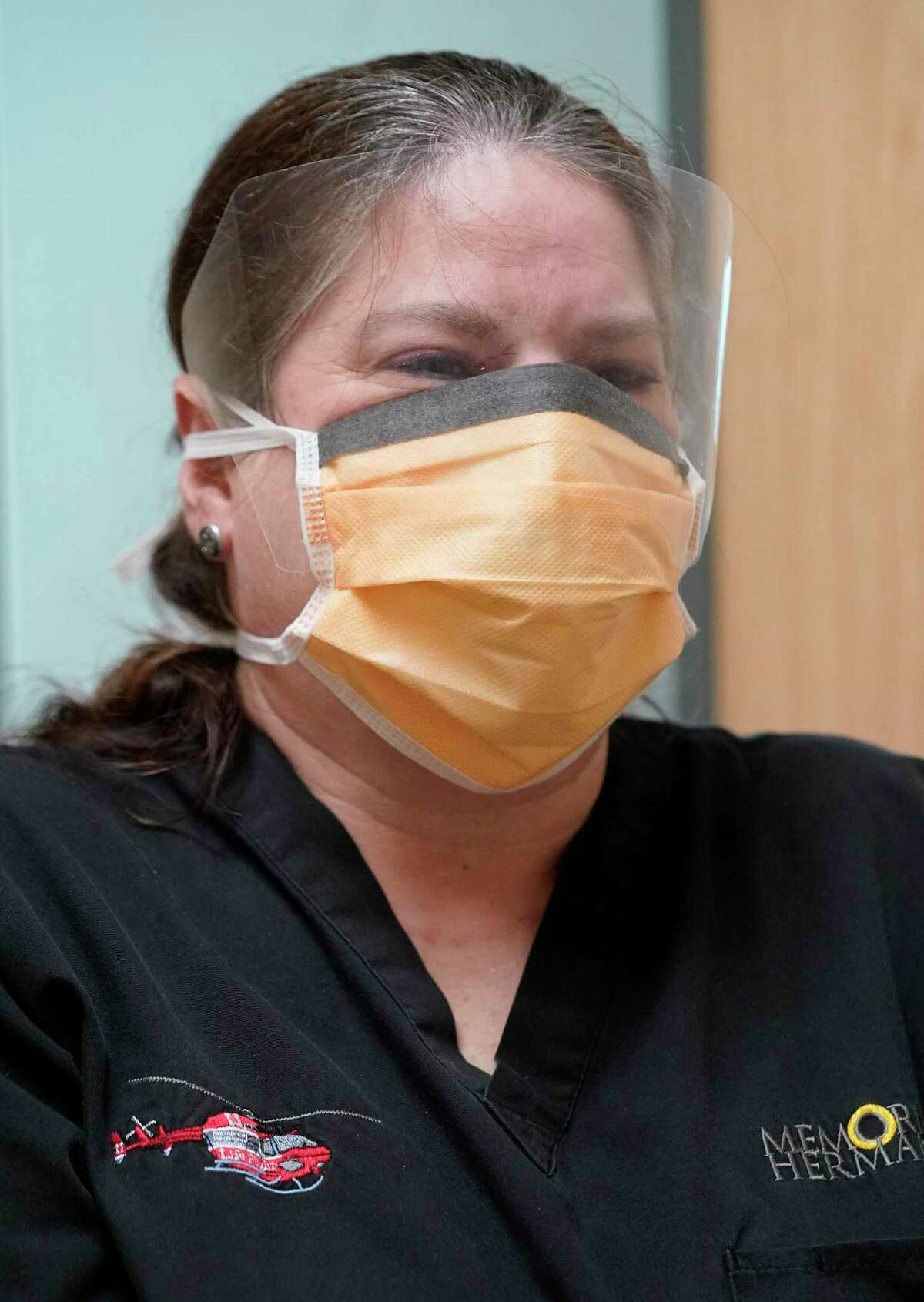 Amy Lopez, RN emergency management coordinator, demonstrates a face shield that is part of the protective equipment that would be worn in a negative pressure patient room at Memorial Hermann Memorial City, 929 Gessner, Tuesday, March 17, 2020, in Houston.