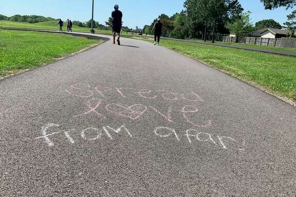 At Pasadena's Crenshaw Park, an anonymous artist left friendly reminders for visitors to practice social social distancing.