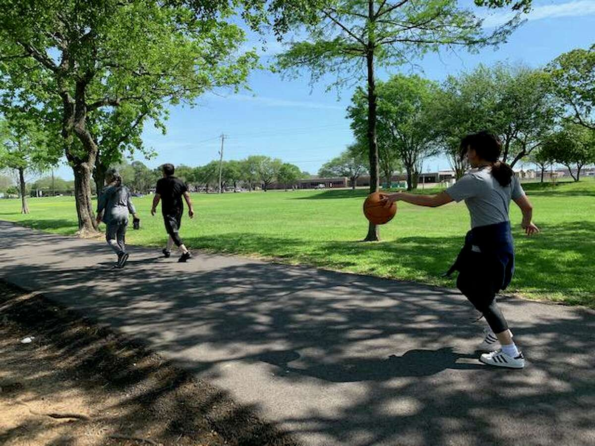 Victoria Aguilar, 12, front, uses a walking trail at Crenshaw Park in Pasadena. The city will conduct a may 28 virtual meeting invited ideas from the community on what park improvements are needed.