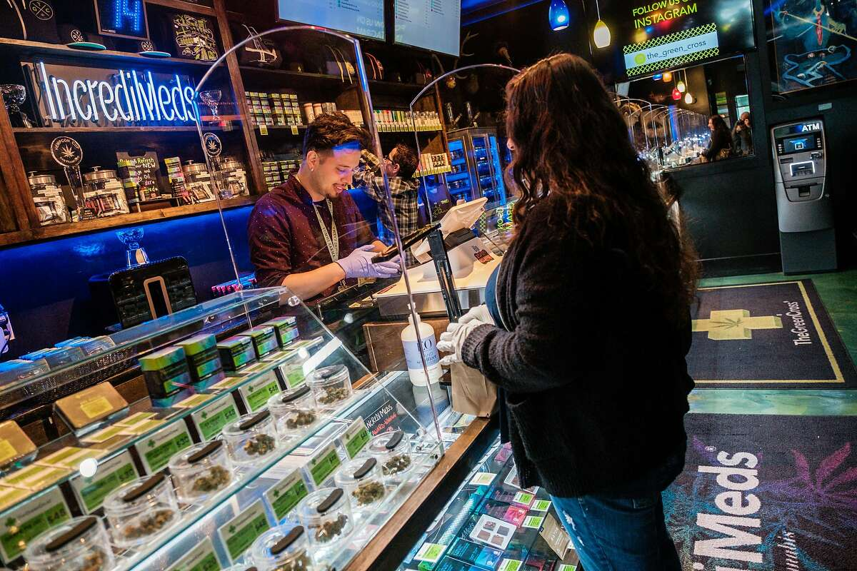 Vincent Barbosa helps a customer at the Green Cross dispensary in San Francisco.