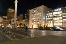 Union Square is empty at night.The normally bustling streets of San Francisco, Calif. on March 26, 2020. are quiet after the city instituted a shelter-in-place order to prevent the spread of the COVID-19 coronavirus.