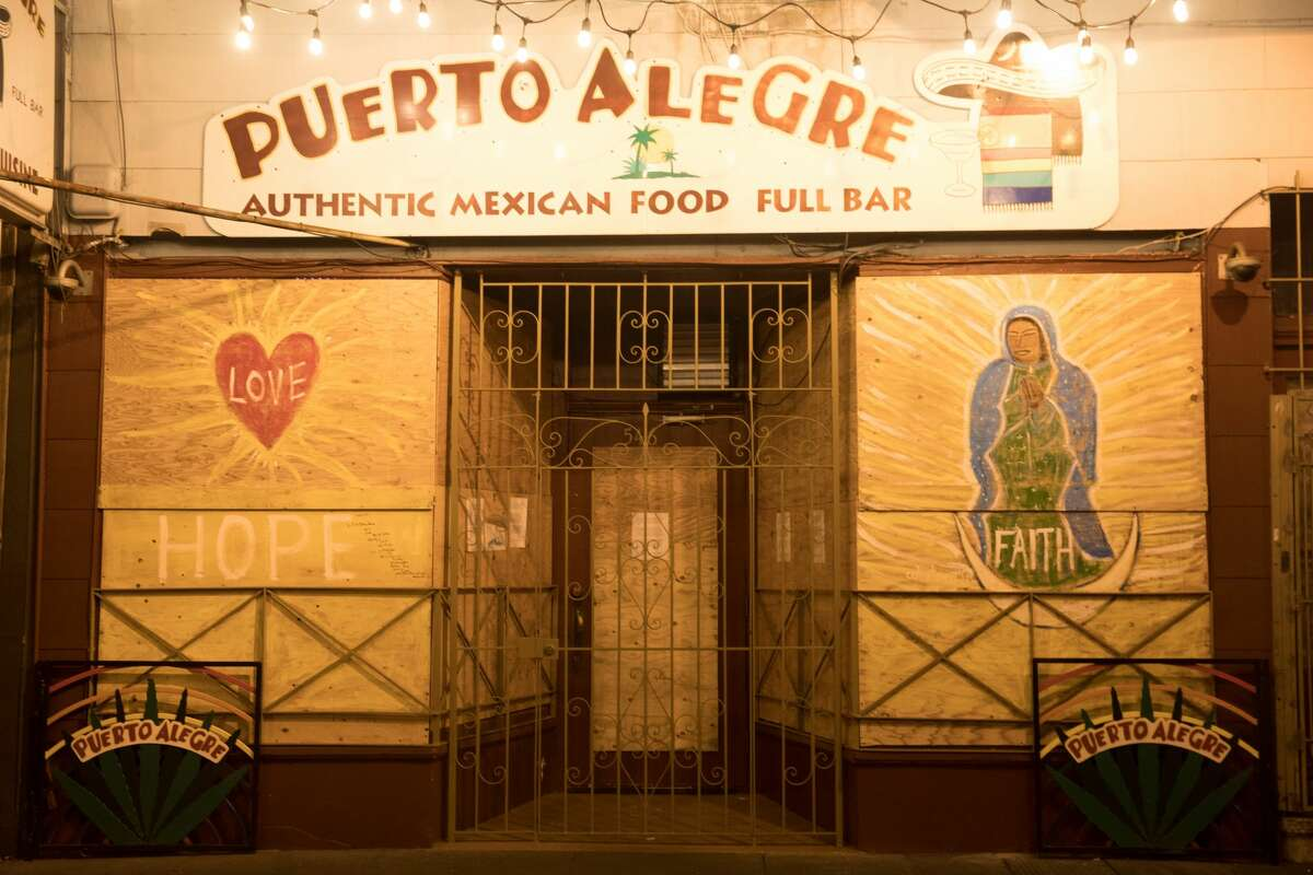 Puerto Alegre restaurant on Valencia Avenue in the Mission District is boarded up. The normally bustling streets of San Francisco on March 26, 2020, are quiet after the city instituted a shelter-in-place order to prevent the spread of the COVID-19 coronavirus.