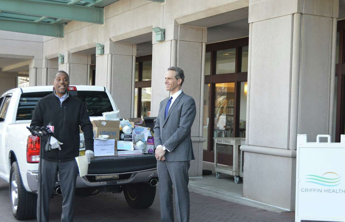 State Sen. George Logan, R-Ansonia, drops off supplies donated by the area's Chinese American community to Griffin Health President and CEO Patrick Charmel.