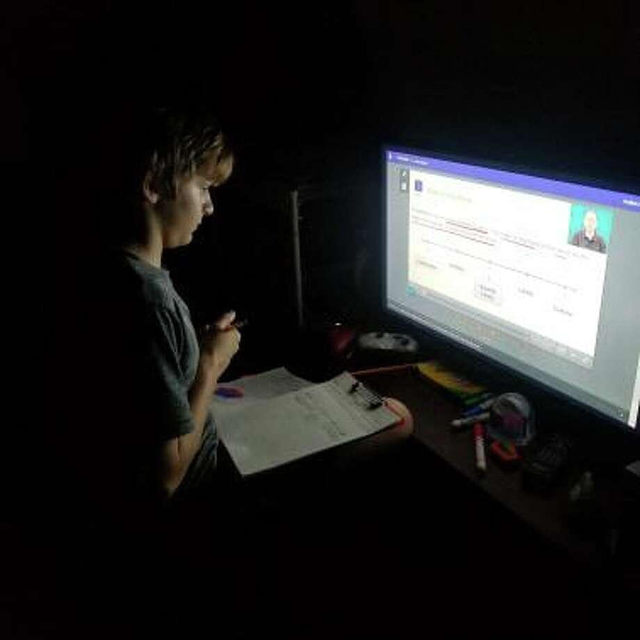 Charity Strickland said her son is using the Cy-Fair ISD Edgenuity online learning system, taking notes and completing assignments throughout the week. Photo: Charity Strickland